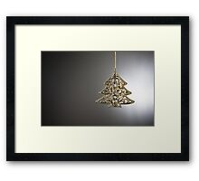 Christmas tree ornament in from of a Christmas tree Framed Print