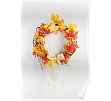 Autumn wreath hanging on a bright door Poster