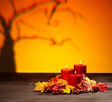 Candles in scary Halloween landscape with dry tree by 3523studio