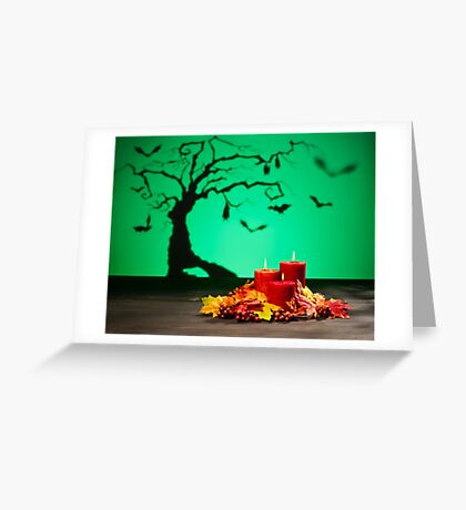 Candles in scary Halloween landscape with bats Greeting Card