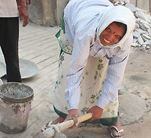 Woman Mixing Cement by Andrew  Makowiecki