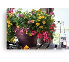 Flowers and empty beer bottle Canvas Print