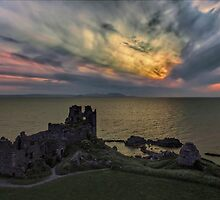 Sunset blast over Dunure Castle by David Alexander Elder