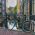 Bike on a bridge, Amsterdam. by naranzaria