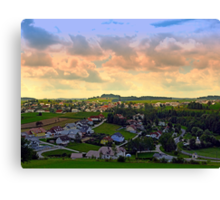 Beautiful village skyline beyond cloudy sky | landscape photography Canvas Print