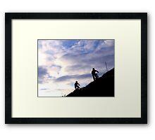 Mountain bikers on skyline Framed Print