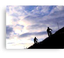 Mountain bikers on skyline Canvas Print