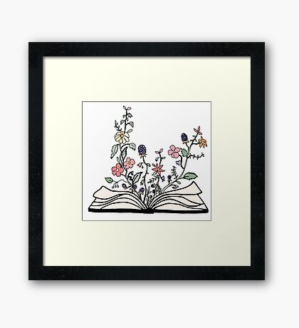 flowers growing from book  Framed Print