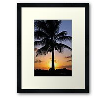 Tropical sunset with red sky, clouds and coconut tree silhouette Framed Print
