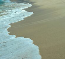 Tropical ocean and beach sand view in the middle of sunny day by Anton Oparin