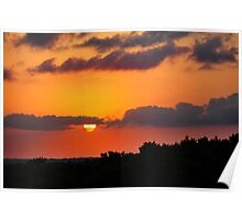 Tropical sunset with red sky, clouds and horizon line Poster