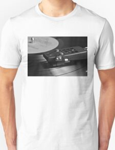 Vinyl record playing on a turntable Unisex T-Shirt