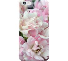 Beautiful small light pink flowers in the garden. iPhone Case/Skin