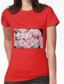 Beautiful small light pink flowers in the garden. Womens Fitted T-Shirt