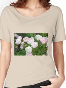 Beautiful small light pink flowers in the garden. Women's Relaxed Fit T-Shirt