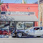 The Bourgeois Pig and an Excalibur Automobile, Lawrence KS  by Paul Danger Kile