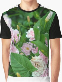 Small pale pink flowers and green leaves. Graphic T-Shirt