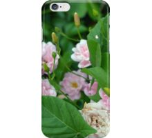 Small pale pink flowers and green leaves. iPhone Case/Skin