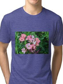 Small pale pink flowers and green leaves. Tri-blend T-Shirt