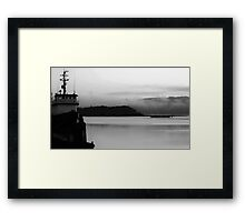 Boat on foggy waters Framed Print