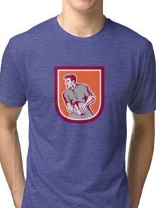 Rugby Player Passing Ball Sideview Retro Tri-blend T-Shirt