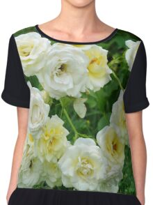 White roses in the garden. Chiffon Top