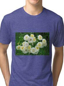 White roses in the garden. Tri-blend T-Shirt