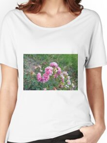 Pink roses in the garden, natural background. Women's Relaxed Fit T-Shirt