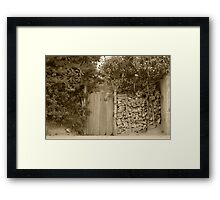 Wood Gate in a Wall of Stones Framed Print