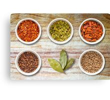 Spices in Pots on Old Wooden Chopping Board Canvas Print