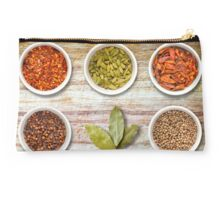 Spices in Pots on Old Wooden Chopping Board Studio Pouch