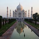 The Taj Mahal and reflective pool at dawn. by John Dalkin