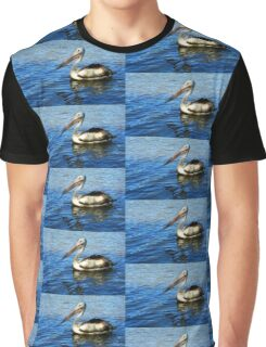 Pelican on blue clear water Graphic T-Shirt