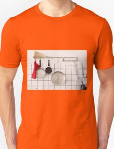Frying pans hang on a wall of a domestic kitchen  Unisex T-Shirt