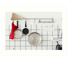 Frying pans hang on a wall of a domestic kitchen  Art Print