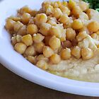 Hummus. A Levantine Arab dip or spread made from cooked, mashed chickpeas,  by PhotoStock-Isra