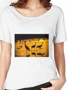 Common crane (Grus grus) Silhouetted at sun-set Women's Relaxed Fit T-Shirt