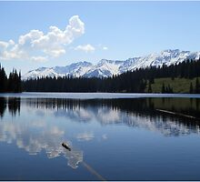 Beautiful Mountains reflecting on a calm lake. by Val  Brackenridge