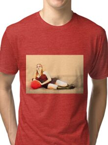 digitally enhanced picture of an arrogant model in red corset  Tri-blend T-Shirt