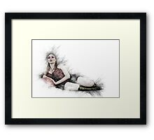 arrogant model in red corset reclining on a black leather couch  Framed Print
