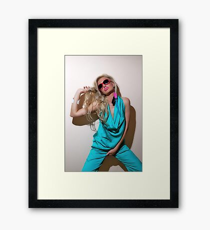 Sexy blond girl in fashion shoot Framed Print