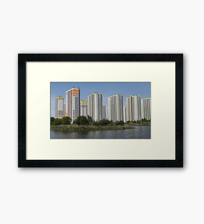 apartment buildings over the water Framed Print