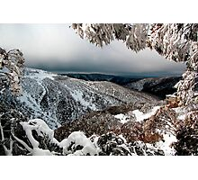Alone on the mountainside in winter Photographic Print