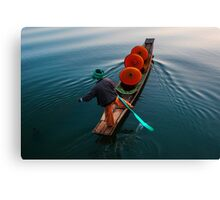 monks under parasols in canoe on Inle lake, Myanmar, Shan state Canvas Print