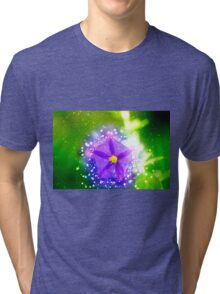 purple garden flower with lush green background  Tri-blend T-Shirt