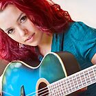 Girl Playing Blue Guitar by ptpop