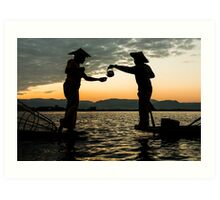 Myanmar, Shan state, Inle lake, two fishermen drinking tea at dusk  Art Print