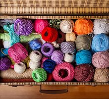 Colorful balls of wool in an old suitcase by Ricard Vaqué