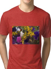Colorful blurry small flowers pattern. Tri-blend T-Shirt