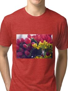 Natural background with small yellow flowers and red fruits. Tri-blend T-Shirt